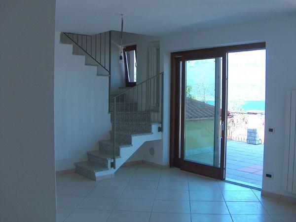 Baveno appartamento vista lago nuovo con garage aa1543 for Log garage con appartamento